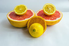 Citrus fruits being cut in half stock images