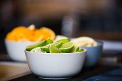 Citrus fruits. Bowls of citrus fruits at a bar Royalty Free Stock Photography