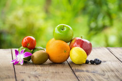 Citrus fruits on a brown wooden table Royalty Free Stock Images