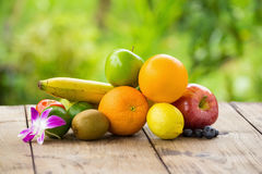 Citrus fruits on a brown wooden table Stock Image