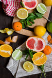 Citrus Fruits on the chopping board Royalty Free Stock Image