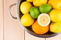 Citrus fruits in colander Royalty Free Stock Images