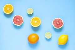 Citrus fruits frame on the blue background. Top view card stock images