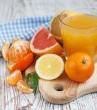 Citrus fruits and fresh orange juice Royalty Free Stock Images