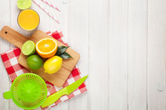 Citrus fruits and glass of juice. Oranges, limes and lemons Stock Photography