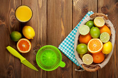 Citrus fruits and glass of juice Royalty Free Stock Photography