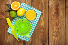 Citrus fruits and glass of juice Stock Photography