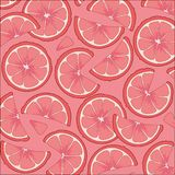 Citrus fruits grapefruit . Grapefruit slices on a pink background. Stock Photos