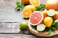 Citrus fruits. With green leafs on wooden table stock photography
