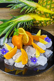 Citrus fruits and ice. Citrus is believed to have originated in the part of Southeast Asia bordered by Northeastern India, Myanmar (Burma) and the Yunnan Stock Photography
