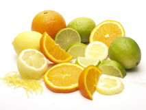 Citrus fruits including orange, lemon and lime. Pile of citrus fruits including orange, lemon and lime. Shot on a white background Royalty Free Stock Photography
