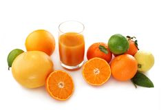 Citrus fruits and juice in glass Royalty Free Stock Image