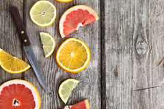 Citrus fruits and a knife Stock Photo