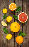 Citrus fruits (lemon, grapefruit and orange) on vintage wood Royalty Free Stock Images