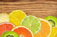 Citrus fruits of lemon, orange, grapefruit, lime on wooden Stock Photos