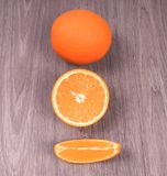 Citrus fruits are lined from whole to sliced royalty free stock photography