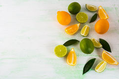 Citrus fruits mix on light green background Royalty Free Stock Photo