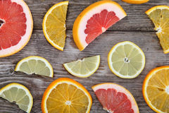 Citrus fruits. Oranges, grapefruits and lemons on a wood table background Stock Images