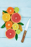 Citrus fruits. Oranges, limes, grapefruits, tangerines and lemons. Over white wood table background with copy space. Top view Stock Photography
