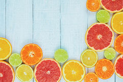 Citrus fruits. Oranges, limes, grapefruits, tangerines and lemons. Over white wood table background with copy space. Top view Royalty Free Stock Photography