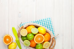 Citrus fruits. Oranges, limes and lemons. Over wooden table background with copy space stock images