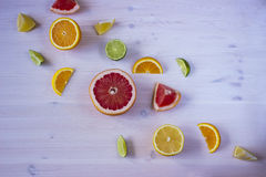 Citrus fruits. Over wood table background. Citrus fruits. Oranges, limes, grapefruit and lemons. Over wood table background Royalty Free Stock Photos