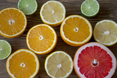 Citrus fruits. Over wood table background. Citrus fruits. Oranges, limes, grapefruit and lemons. Over wood table background Royalty Free Stock Photography