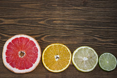 Citrus fruits. Over wood table background. Citrus fruits. Oranges, limes, grapefruit and lemons. Over wood table background with copy space Stock Photo
