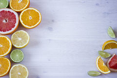 Citrus fruits. Over wood table background. Citrus fruits. Oranges, limes, grapefruit and lemons. Over wood table background with copy space Stock Image