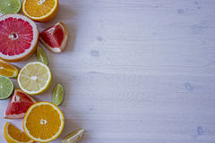 Citrus fruits. Over wood table background. Citrus fruits. Oranges, limes, grapefruit and lemons. Over wood table background with copy space Royalty Free Stock Photos