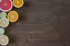 Citrus fruits. Over wood table background. Citrus fruits. Oranges, limes, grapefruit and lemons. Over wood table background with copy space Stock Photography