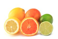 Citrus fruits. Partly piece cut: lemon, orange and lime, isolated against white background Stock Photos