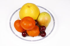 Citrus fruits on the plate Royalty Free Stock Images