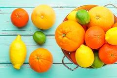 Citrus fruits in retro colander. Royalty Free Stock Image