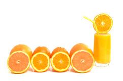 Citrus fruits in a row with glass of orange juice Royalty Free Stock Photography