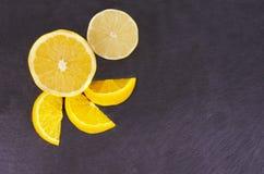 Citrus fruits on slate Stock Photo