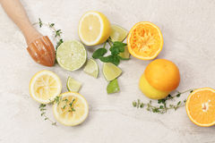 Citrus fruits. Still life with citrus fruits and wooden citrus squeezer on granite table, top view Stock Image