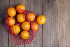 Citrus Fruits Tangerine in Oranges in plastic net bag package. no plastic concept. Packaging that does not recycle. Plastic. Rusti. Citrus Tangerine in Oranges stock images