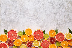 Citrus fruits vegan mix flat lay on white background, helthy vegetarian organic food stock image
