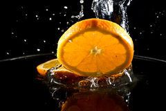 Citrus fruits in water Stock Photo