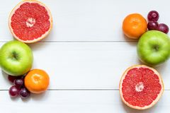 Citrus fruits on the white wooden table, copy space stock photos