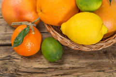 Citrus fruits on wood Royalty Free Stock Images