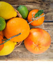 Citrus fruits on wood Stock Photography