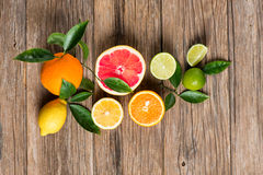 Citrus fruits  on a wooden table Royalty Free Stock Photos