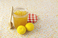 Citrus jam in glass bin. On a table Stock Photography