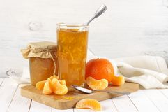 Citrus jam in glass jars and orange slices royalty free stock photography