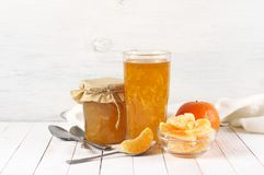 Citrus jam in glass jars and orange slices stock photography