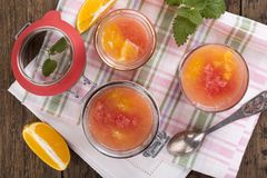 Citrus jelly in a glass jar royalty free stock images