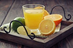 Citrus juice and fruits Stock Image
