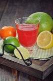 Citrus juice and fruits Stock Photos